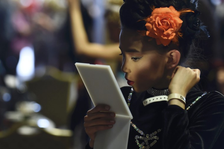 Image: Emelie Wong aged 11 of the Turley Duggan dance school from Birmingham gets ready  before competing at the World Irish Dancing Championships