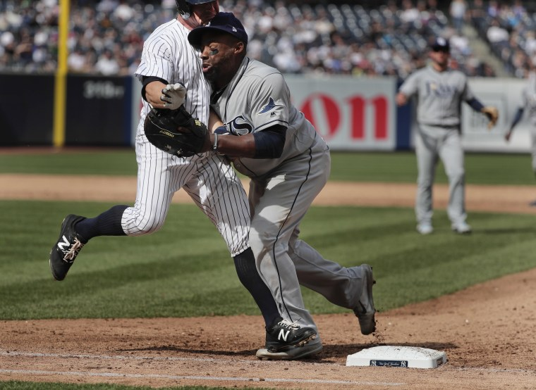 Image: New York Yankees' Brett Gardner, left, collides with Tampa Bay Rays first baseman Rickie Weeks