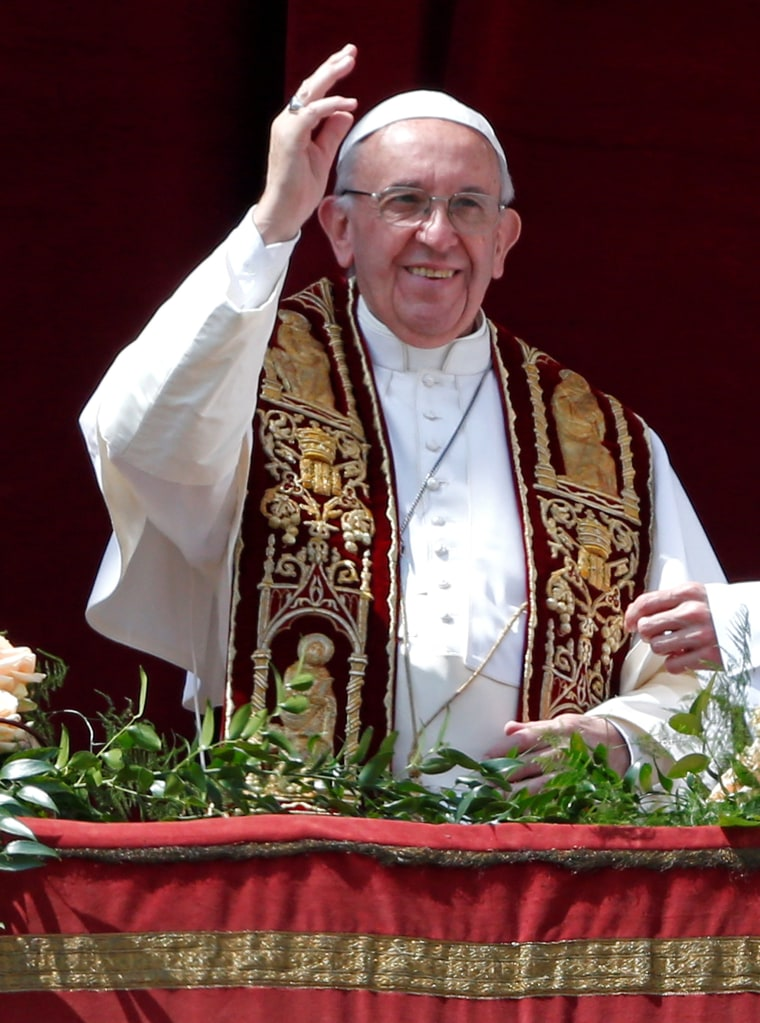 Image: Pope Francis waves during his Easter Sunday address.