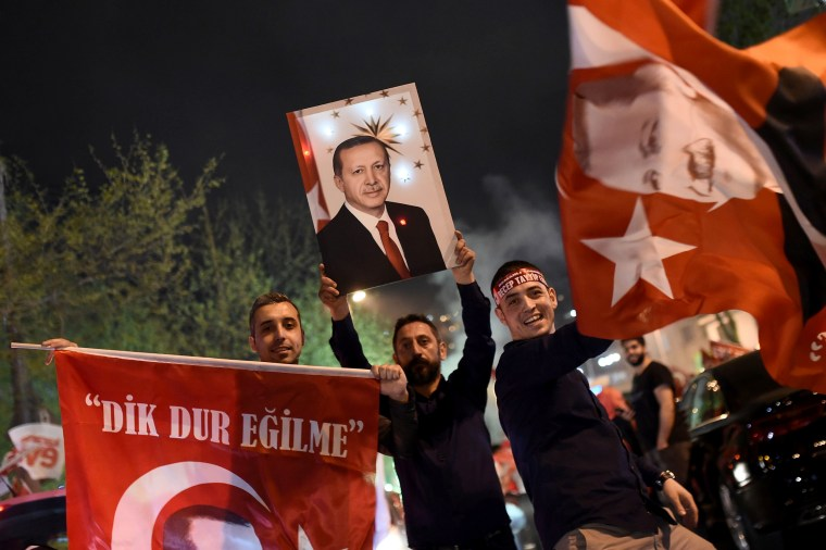 Image: Supporters of Turkish President Recep Tayyip Erdogan during a rally near the headquarters of the conservative Justice and Development Party (AKP) on April 16, 2017 in Istanbul, after the initial results of a nationwide referendum.