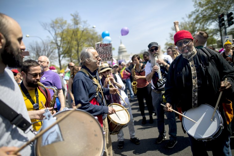Image: Protesters play music while demanding Trump release his tax returns, outside the Capitol building in Washington, DC.