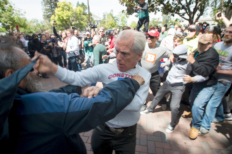 Image: Two men fight during a pro-Trump rally in Berkeley. Ultimately, more than a dozen people were arrested.