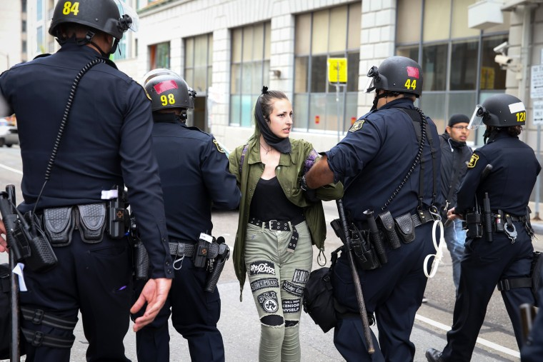 Image: A protester is arrested following the eruption of fights in Berkeley.
