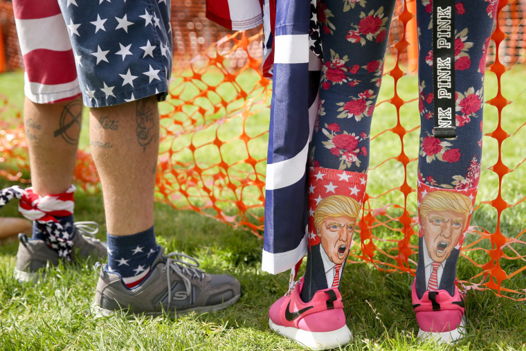 Image: A Trump supporter sports Trump socks in Berkeley.