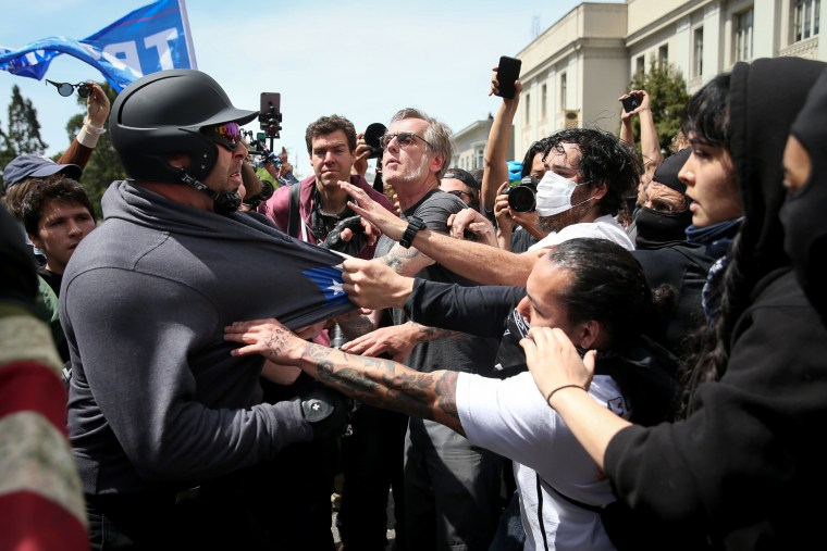 """Image: Trump supporters clash with protesters at the \""""Patriots Day\"""" free speech rally on April 15, in Berkeley."""
