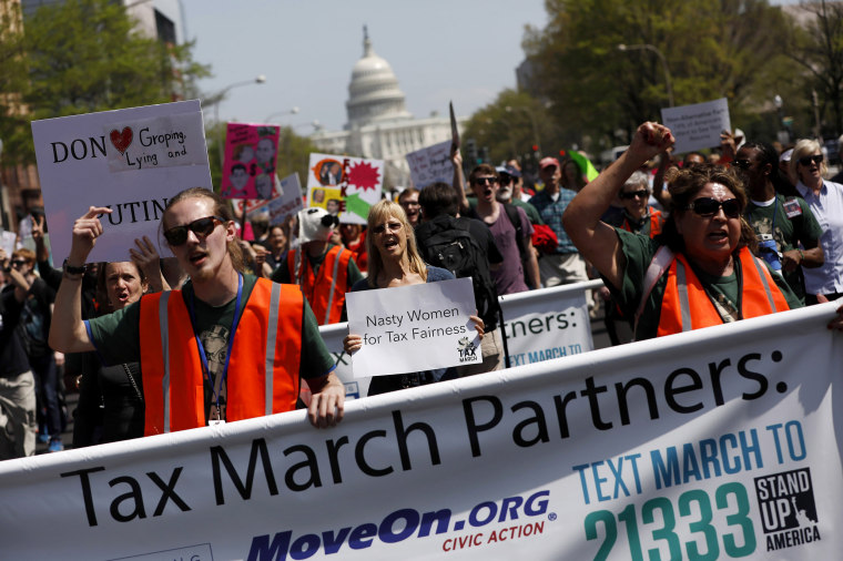 Image: Tax Day demonstrators march away from the U.S. Capitol in Washington, DC.
