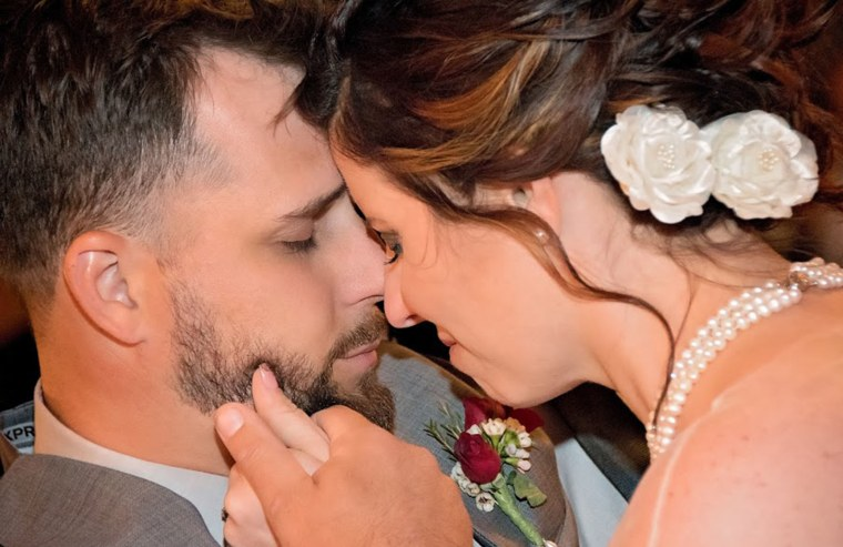 Paralyzed groom surprises wife for first dance.