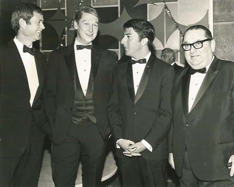 In order from left to right: Larry, Mike Nichols, Dustin Hoffman, and Joseph Levine.