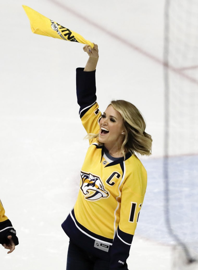 Carrie Underwood performs the national anthem