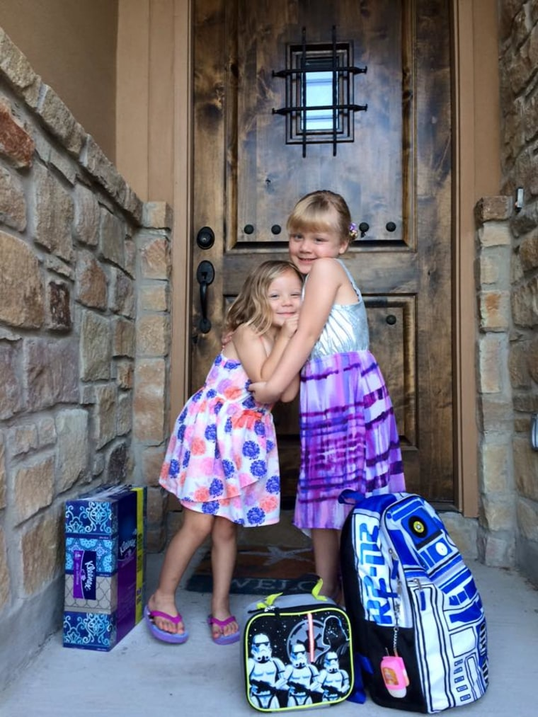 Violet, 5, with her sister, Sunny, 7.