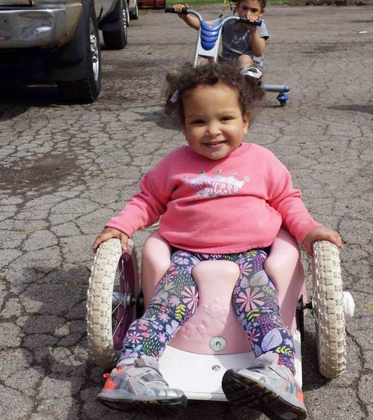 Thanks to a Bumbo-seat wheelchair, Bella Shorr can chase her brother and sister around outside.