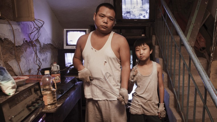 "Zhao Jun as Big Wong and Wang Naixun as Little Wong in ""King of Peking."""