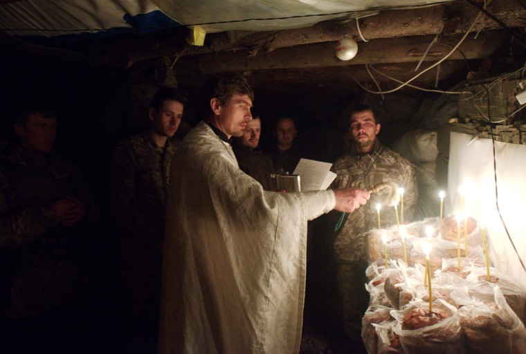Image: Priest blesses Easter cakes to mark Orthodox Easter at position of Ukrainian troops