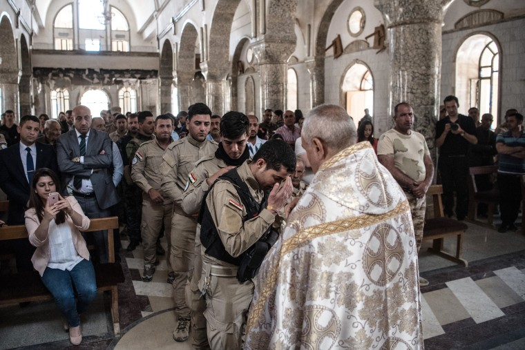 Image: Iraqi Christians Attend Easter Service