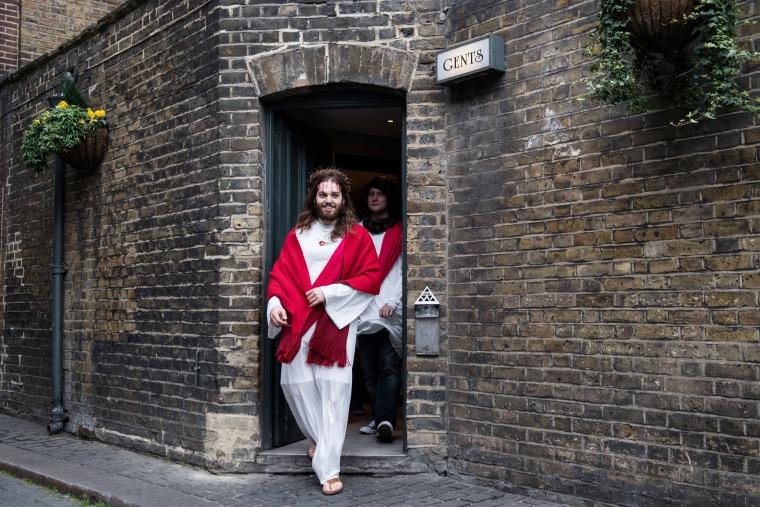 Image: Luigi Pertrilli walks out of a public toilet during the Christathon X pub crawl in London
