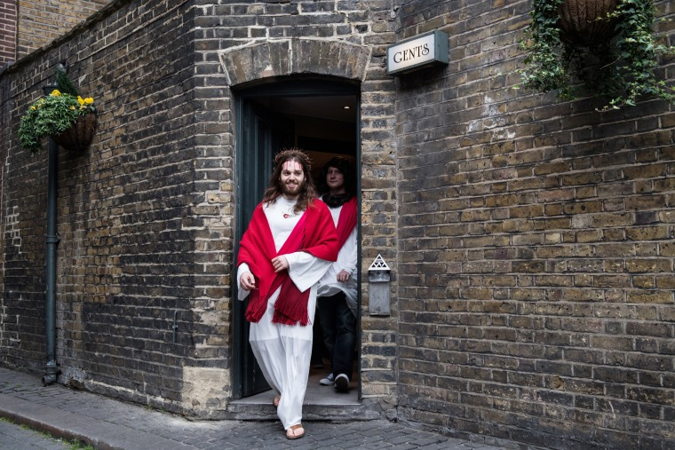 Image: Luigi Pertrilli walks out of a public toilet during the Christathon X pub crawl in London