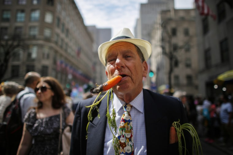 Image: A man smokes a cigar as he attends the annual Easter Parade in New YOrk