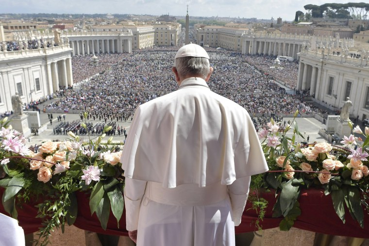 Image: Pope Francis addresses the crowd prior to delivering his Urbi et Orbi  at the Pope Francis addresses the crowd prior to delivering his Urbi et Orbi at the Vatican