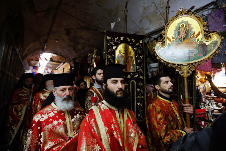 Image: Greek Orthodox clergymen march during the Easter Sunday procession in Jerusalems Old City