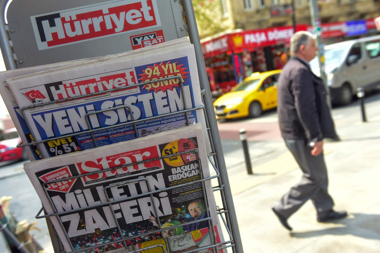 """Image: Hurriyet (top) carried the headline """"New System"""" and while the Star bore the headline """"Victory of the people"""""""