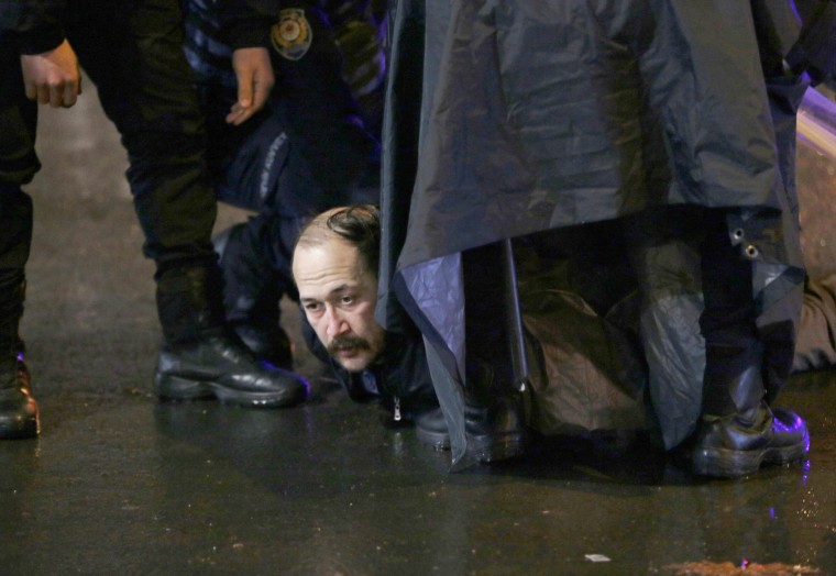 Image: Riot police officers detain a protester outside the Supreme Electoral Board in Ankara, late Sunday night, April 16.