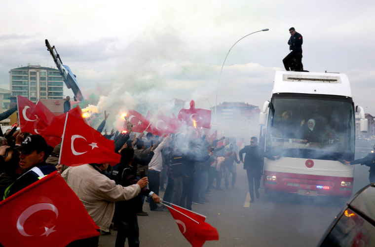 Image: The president is greeted by his supporters as he leaves Esenboga Airport in a bus in Ankara, April 17.
