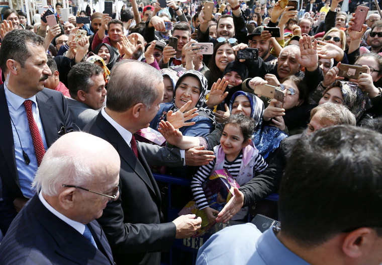 Image: President Erdogan greets people, accompanied by Turkish parliamentary speaker Ismail Kahraman after praying at Eyup Sultan mosque in Istanbul, April 17.