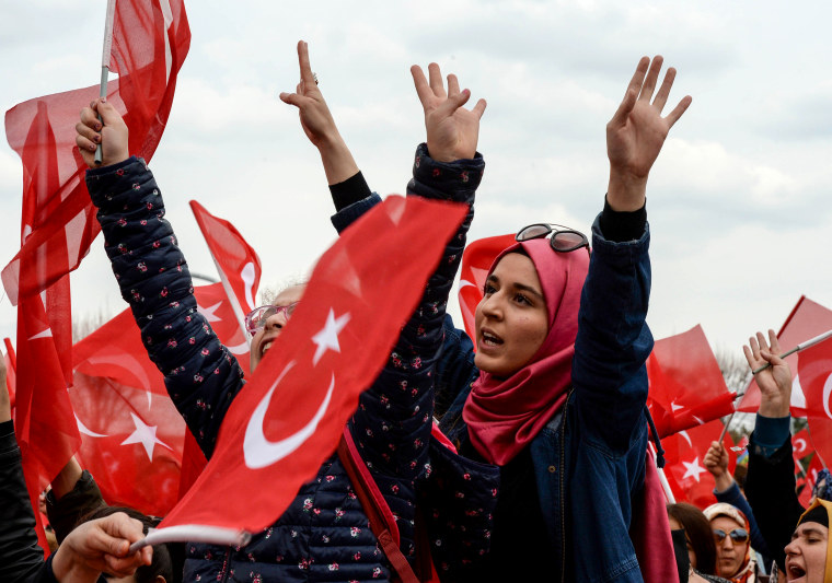 Image: Supporters of the president await his arrival to Ankara on April 17.