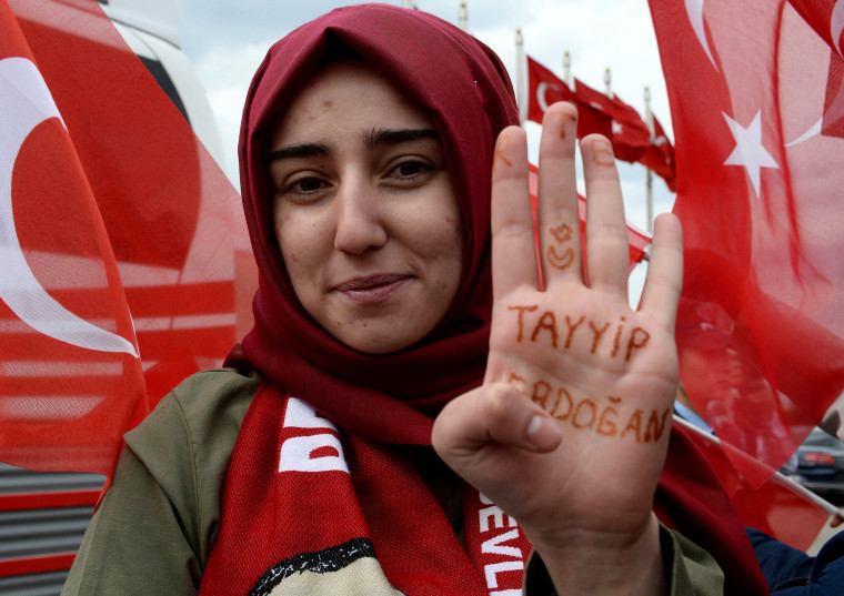 Image: Supporters celebrate while waiting for President Erdogan to arrive at the presidential palace.