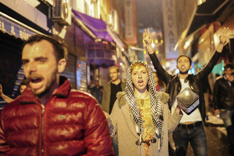 Image: Opponents of the referendum chant slogans as they protest in Istanbul into the early Monday morning hours, April 17.