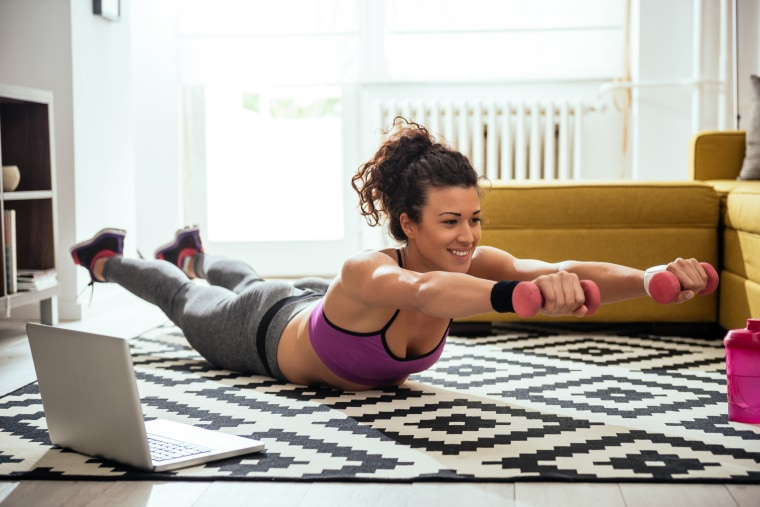 Image: Woman working out at home with computer