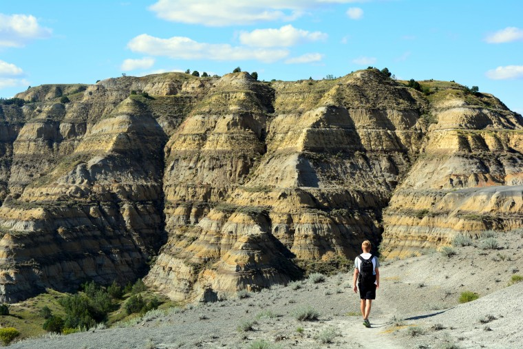 Mikah Meyer walking in his favorite national park so far, Theodore Roosevelt National Park in North Dakota.