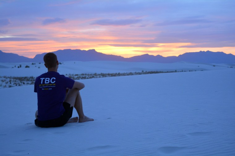 Mikah Meyer watching the sun set at White Sand National Monument in New Mexico