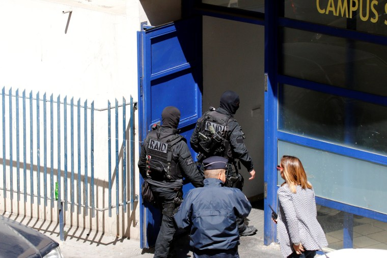 Image: French police raided addresses in Marseilles