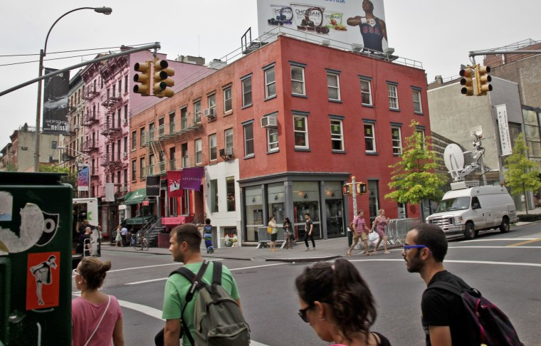 Image: A residential storefront building at the corner of Prince Street and Broadway