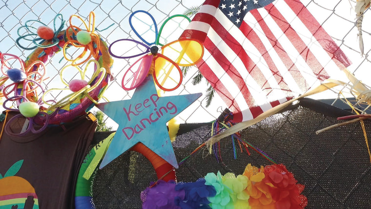 """Film still from """"Love the Sinner"""" of a memorial for the victims of the Pulse nightclub shooting in Orlando, Fla."""
