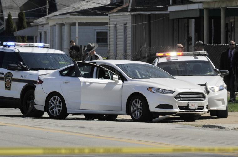 Image: Police investigate the scene where Steve Stephens was found shot dead