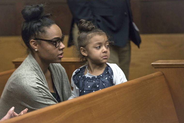 Image: Shayanna Jenkins Hernandez sits in the courtroom with the couple's daughter during jury deliberations