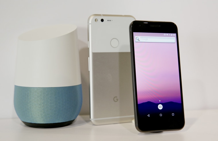 Image: The new Google Pixel phone is displayed next to a Google Home smart speaker
