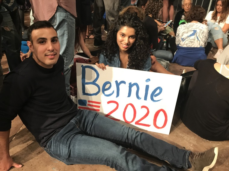 Shadi Toro, a 26 year old, South Florida resident and his girlfriend attend the Come Together and Fight Back tour in Miami on 4/19/17.