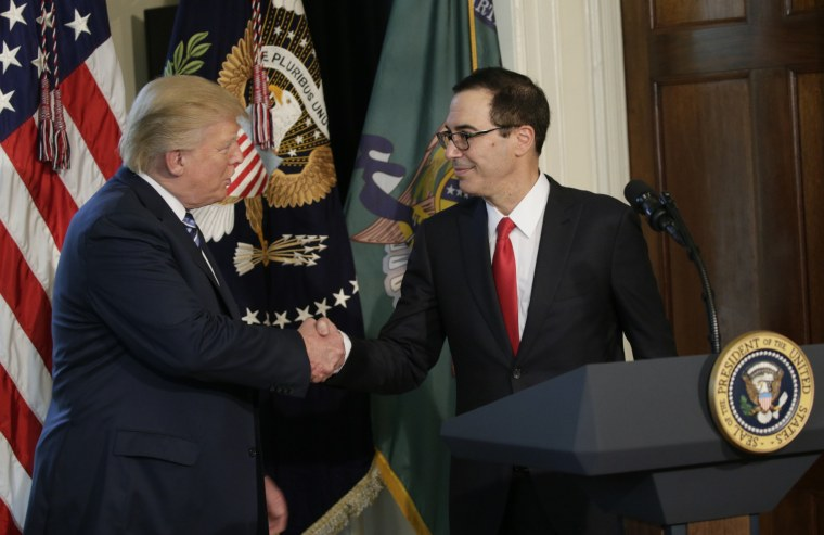 Image: U.S. President Trump greets Treasury Secretary Mnuchin during signing financial services executive orders signing ceremony at the Treasury Department in Washington