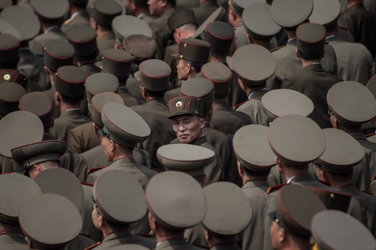 Image: North Korean soldiers watch a military parade