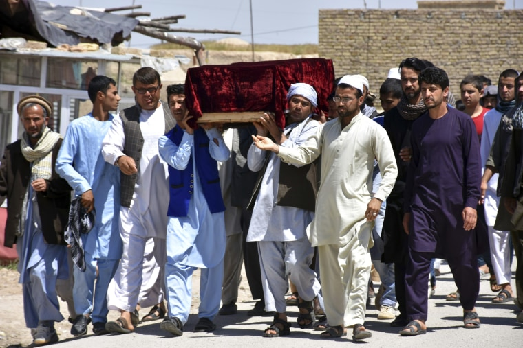 Image: Men carry the coffin of one of the victims after Friday's attack at a military compound in Mazar-e-Sharif province north of Kabul, Afghanistan, April 22, 2017.