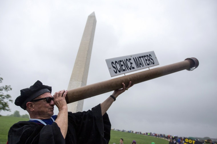 Image: A man gestures with 'Galileo's light' in Washington, DC.