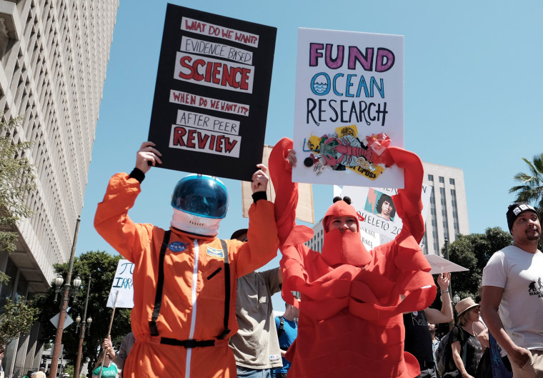 Image: Scientists and supporters dress is costume for the Los Angeles march.