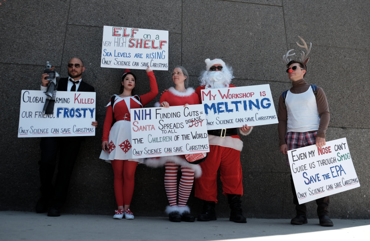 Image: Demonstrators use Christmas to illustrate the importance of science in Los Angeles, California.