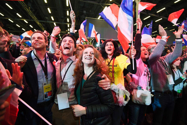Image: Supporters of French presidential election candidate Centrist Emmanuel Macron celebrate after the results of the first round of the presidential elections