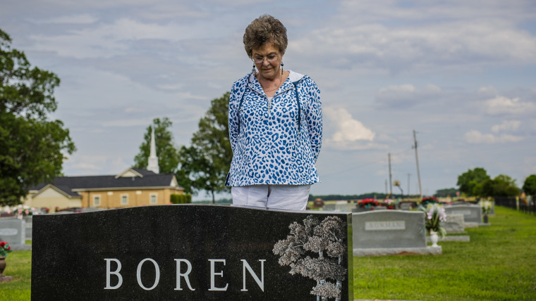 Dumas, AR - Genie Boren stands at the grave of her husband, Cecil Boren, who was murdered in 1999.