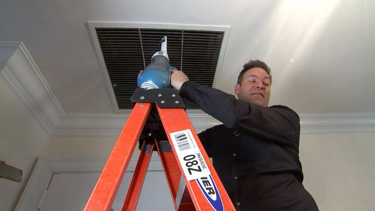 Jeff Rossen vaccums dust off his air vent.