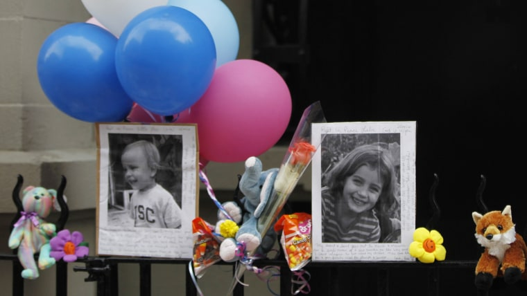 Pictures of Lucia and Leo Krim at a memorial outside their New York apartment building in this 2012 photograph.